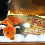 Frasier Fox rests on a Braided Hunt Rug